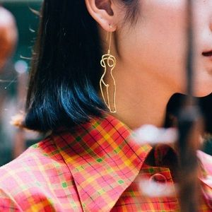 Jewelry - Gold color abstract earrings